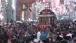 Tourist Tram Drives Through Busy Shopping Street I stock footage