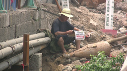 Worker Reads Newspaper In Polluted Environment In stock footage