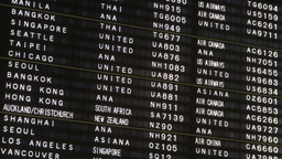 Schedule Board At Narita Airport, Tokyo stock footage