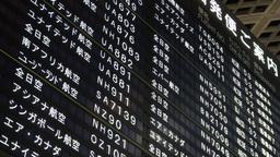 Schedule board at Narita international airport Tok Footage