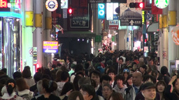 Busy shopping street at night in Osaka Japan Footage