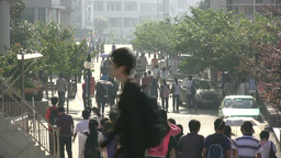 Students at campus going to class in China Footage