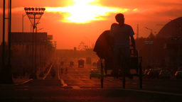 Friends on tricycle at sunset in Chinese city Footage