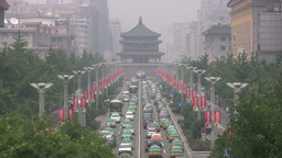 Traffic and pagoda in smog in Xian China Footage