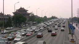 Traffic and Lama temple in Beijing China Footage