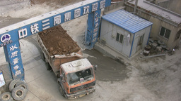 China Industry, truck drives towards construction Footage