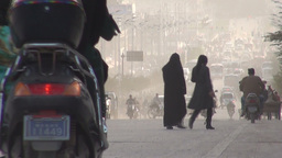 Veiled women cross busy street in Kashgar Footage