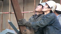 Workers in China holding pieces of metal Footage