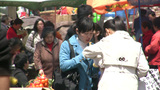 Young women eating at market in China Footage