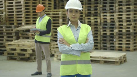 Female engineer standing and male engineer using digital… Stock Video Footage