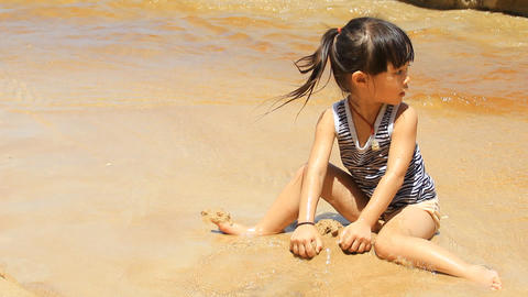 Child On The Beach stock footage
