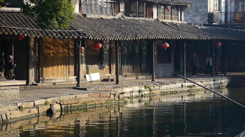 Tourists stroll through Traditional Chinese houses in XiTang Water Town,shanghai Animation