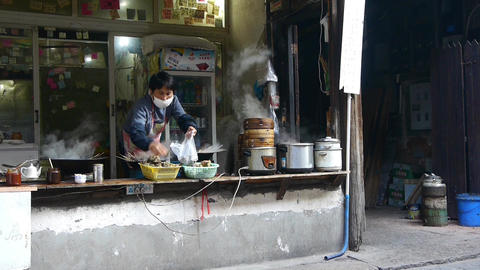 Typical chinese bun stand,a woman preparing breakfast,fresh buns with steam Animation