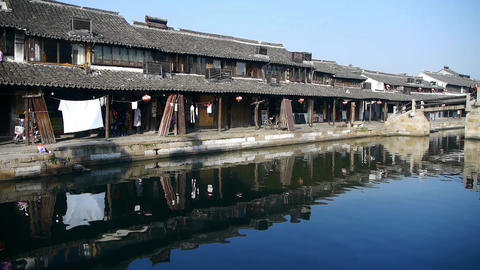 Traditional Chinese houses reflection on blue water,XiTang Water Town Animation