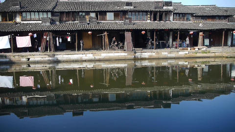 Chinese ancient houses reflection on water,XiTang Water Town resident life Animation