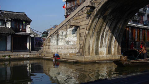 boating through Chinese ancient bridge,water town resident life Animation