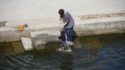 chinese woman wash mop in river Animation