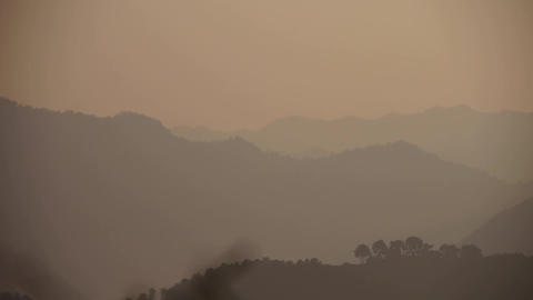 looking around layers of mountains at dusk Animation