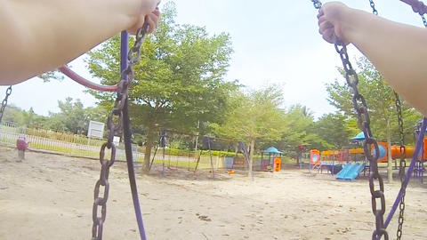slow motion swing and playground Live Action