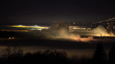 Night fog covers Lions Gate Bridge in Vancouver Footage