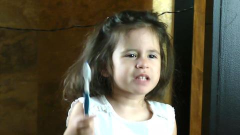 Little girl brushing her teeth Footage