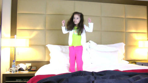 Little girl jumping in bed Footage
