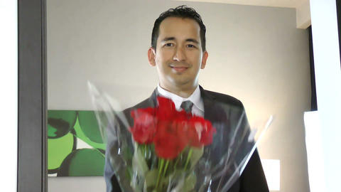 Man giving bouquet of red roses Footage