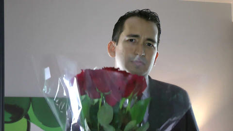 handsome man with flowers in hand feeling guilty s Footage