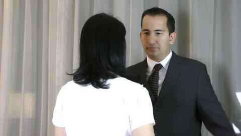 A husband embrace his sad wife Live Action