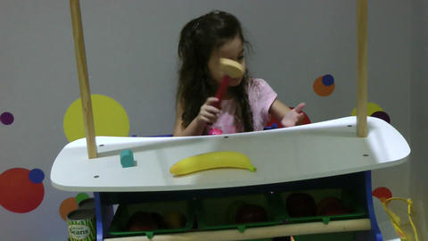 Happy Little Girl Playing With Color Toys stock footage