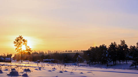 Sun rises over the winter landscape. Time Lapse. 1 Footage