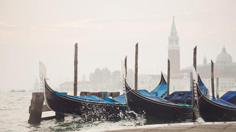 Venetian gondolas tied near the pier on San Marco  Footage