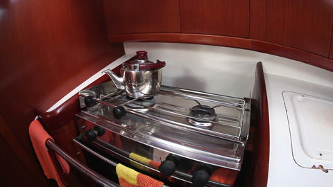 Kettle On The Gas Stove In Yacht Cook Room, Sailin stock footage