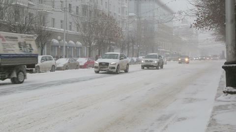 cars on a city street in a blizzard Footage