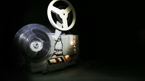 old projector showing film on screen - dolly shot Footage