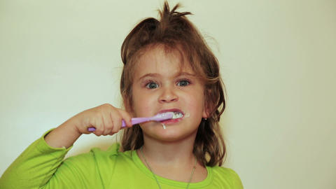 pretty little girl brushing her teeth Footage