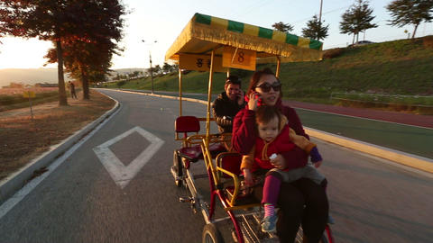 Family In A Pedal Bus 2 stock footage