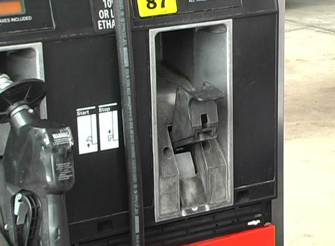 Placing the Handle of a Gas Pump into the Pump Stock Video Footage