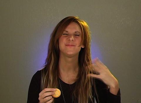 Beautiful Blonde Eating Crackers (3) Stock Video Footage