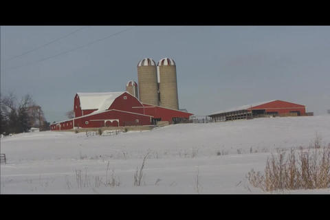 Barn on hill distant Stock Video Footage
