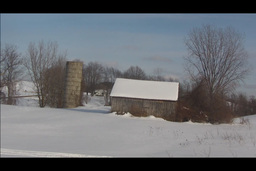 lonely barn and silo in distance Stock Video Footage