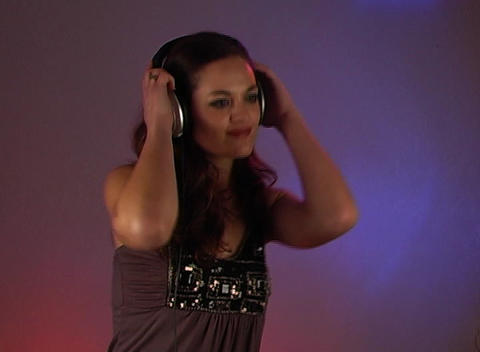 Beautiful Brunette Listens to Music with Headphones (1) Stock Video Footage