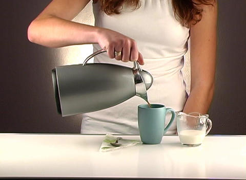 Woman Pouring Coffee, Studio Setup (2a) Footage