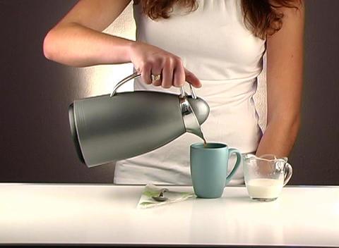 Woman Pouring Coffee, Studio Setup (2a) Stock Video Footage