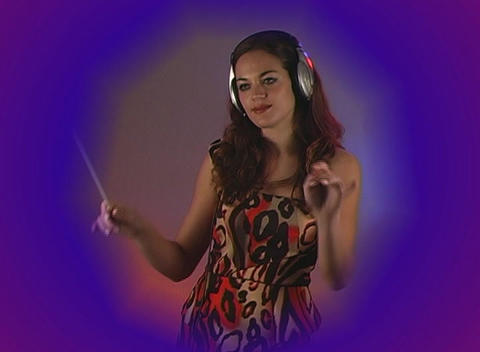 Beautiful Brunette Directs an Imaginary Orchestra Stock Video Footage