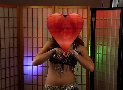 Beautiful Exotic Belly Dancer with Heart Graphic (2) Stock Video Footage