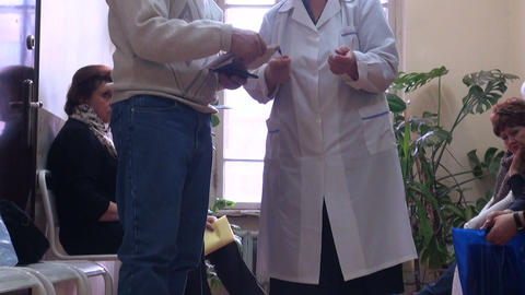 Turn To A Doctor. Patients In The Clinic stock footage