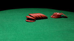 Poker chips on green table Stock Video Footage