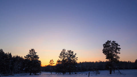 Winter landscape at sunset. Time Lapse Footage