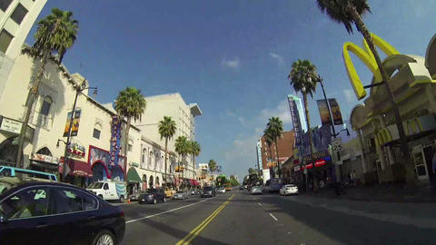 HOLLYWOOD - CIRCA 2014: POV Driving Down Hollywood stock footage
